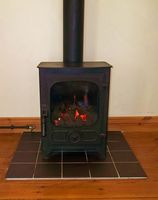 he gas fired woodburner provides a cosy ambience